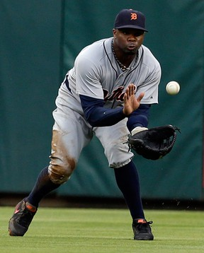 Tigers centre-fielder Rajai Davis catches a fly ball by Elvis Andrus of the Rangers in the first inning Wednesday. (AP Photo/Tony Gutierrez)