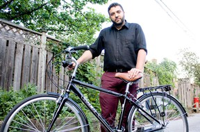 Adriano Ciotoli from WindsorEats stands with a 2013 Trek Allants bike at his Walkerville neighbourhood home Sunday, June 22, 2014. Five Trek bikes were stolen from his garage early Sunday morning. (JOEL BOYCE/The Windsor Star)
