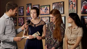 WINDSOR, ONT.: (6/17/14) -- University of Windsor students, from right to left, Laura Sorge, Rachel Stadder and Shannon McLaughlan present a $1,000 donation to Postmedia's Raise-a-Reader campiagn, Tuesday, June 17, 2014, inside the Windsor Star News Cafe. The funds were raised by the Editing and Publishing Practicum classes. (RICK DAWES/The Windsor Star)