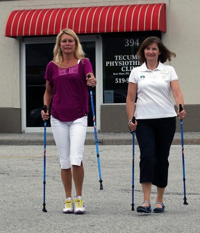Registered physiotherapist Carolyn Sivitter, right, and The Star's Kelly Steele demonstrate nordic pole walking earlier this week. (NICK BRANCACCIO / The Windsor Star)