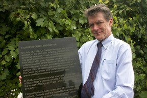 Paul Bunnett-Jones, president of the Leamington-Mersea Historical Society, with a plaque that will be unveiled Saturday at 2 p.m. at the Mersea Municipal Park on Point Pelee Drive to commemorate a July 14, 1814 deadly skirmish at Sturgeon Creek. (Dylan Kristy/The Windsor Star)