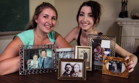 Chelsea Meloche, left, and her sister Kellie Meloche pose with snapshots from their Meloche and Michaelis families Friday September 5, 2014. Chelsea Meloche won the Mike Brede Genealogical Essay competition. (NICK BRANCACCIO/The Windsor Star)