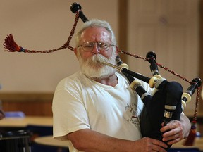Tom Fox of the Scottish Society of Windsor Pipe Band is shown during a practice Thursday, Sept. 18, 2014, at the Scottish Club of Windsor.   (DAN JANISSE/The Windsor Star)