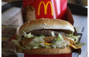 McDonald's Big Mac sandwich at a McDonald's restaurant in Robinson Township, Pa. The world's biggest hamburger chain is confronting unappetizing questions as part of a U.S. campaign to beat back perceptions that it serves Frankenfood. The company has run similar campaigns in Canada and Australia and said Monday, Oct. 13, 2014, it's bringing the effort to its flagship market. (AP/ Gene J. Puskar, File)