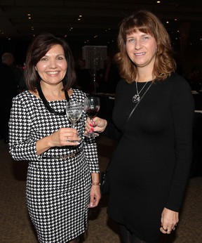 Pat Strome, left, and Susan Dunbar attend Wines of the World at St. Clair College Centre for the Arts, Friday October 24, 2014.  Proceeds support Rotary Club of Windsor-Roseland. (NICK BRANCACCIO/The Windsor Star)
