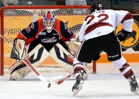 Windsor goaltender Alex Fotinos, left, stops Guelph's Pius Suter during OHL action in Guelph Friday. (Tony Saxon/Guelph Mercury)