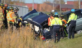 Emergency crews work at the scene of an accident along an on-ramp to EC Row Expressway and Lauzon Parkway on Sunday, Oct. 26, 2014. (DAX MELMER/The Windsor Star)