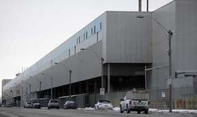 Vehicles drive by Chrysler's Windsor Assembly Plant on Jan. 16, 2015.  (DAX MELMER/The Windsor Star)