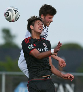 The Windsor Stars Micheal Pio and Robert Boskovic from Toronto FC head the ball at McHugh Park in Windsor on Tuesday, June 24, 2015.                  (TYLER BROWNBRIDGE/The Windsor Star)