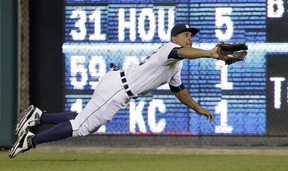 DETROIT, MI - JUNE 2:  Center fielder Anthony Gose #12 of the Detroit Tigers makes a diving catch on a fly ball hit by Ben Zobrist of the Oakland Athletics during the ninth inning at Comerica Park on June 2, 2015 in Detroit, Michigan. (Photo by Duane Burleson/Getty Images)