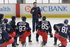 Harrow's Lee Harris, centre, talks to top prospects of the Columbus Blue Jackets during the team's development camp in Columbus last week. (Courtesy of Jamie Sabau)