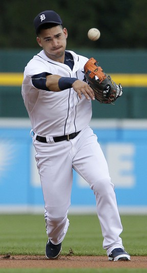 Shortstop Jose Iglesias #1 of the Detroit Tigers throws out Manny Machado of the Baltimore Orioles at first base on a grounder during the first inning at Comerica Park on July 17, 2015 in Detroit, Michigan. (Photo by Duane Burleson/Getty Images)