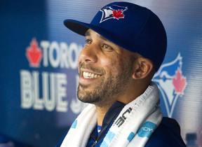 Toronto Blue Jays newly acquired starting pitcher David Price smiles in the dugout as his team plays against the Kansas City Royals during second inning AL baseball action in Toronto on Friday, July 31, 2015. THE CANADIAN PRESS/Fred Thornhill