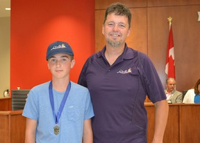 Shayne O'Dwyer, left, was presented with a citizen award by LaSalle coun. Jeff Renaud at the Tuesday, Aug. 11 council meeting. O'Dwyer, 13, raised $3,000 for MS during this year's fundraising ride from Grand Bend to London and back. It was the sixth year he rode in the event. (JULIE KOTSIS/The Windsor Star)