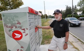 Riverside Drive resident Paul Murray stands next to a new Canada Post mailbox in the 11000 block of Riverside Drive east in Windsor, Ont. on Aug. 17, 2015.  (JASON KRYK/The Windsor Star)
