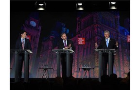 Liberal Leader Justin Trudeau, left, NDP Leader Tom Mulcair and Conservative Leader Stephen Harper take part in the leaders' debate as moderator David Walmsley looks on Thursday, September 17, 2015 in Calgary. (Sean Kilpatrick/The Canadian Press)