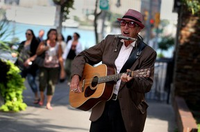 The Downtown BIA is sponsoring street entertainment in front of bars this weekend. Here street musician Raynond Cool, 64, sings in both official languages on Ouellette Avenue Tuesday September 15, 2015.