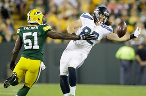 Seattle Seahawks' Luke Willson catches a pass in front of Green Bay Packers' Nate Palmer (51) during the second half Sunday, Sept. 20, 2015, in Green Bay, Wis. (AP Photo/Jeffrey Phelps)