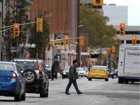 Pedestrians are shown on University Avenue near downtown Windsor, Ont. on Tuesday, Oct. 13, 2015.
