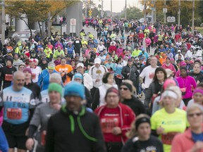 Runners make their way down Riverside Drive in downtown Windsor for the 38th Detroit Free Press/Talmer Bank Marathon, Sunday, Oct. 18, 2015.  (DAX MELMER/The Windsor Star)