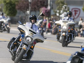 The OPP Golden Helmets Motocycle Precision Team perform on Tecumseh Rd. in Tecumseh, on Oct. 11, 2015.  The Golden Helmets were formed in 1963 and tour the province of Ontario giving exhibitions of their riding skill.