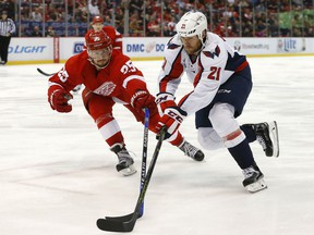 Detroit Red Wings defenseman Mike Green (25) defends Washington Capitals center Brooks Laich (21) in the third period of an NHL hockey game Tuesday, Nov. 10, 2015, in Detroit. (AP Photo/Paul Sancya)