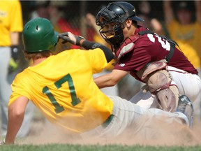 WINDSOR, ONT.:AUGUST 9, 2014 -- Curtis Rodrigues,  from the Sun Parlour Baseball Association, slides safely into home as the London District Baseball Association's Zach Kowalczyk is late with the tag during the Ontario Summer Games at Mic Mac Park, Saturday, August 9, 2014.  (DAX MELMER/The Windsor Star)