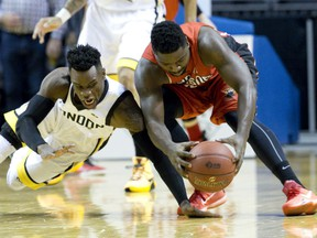 Windsor Express player Raheem Singleton recovers his fumbled ball before London Lightning player Tyshawn Patterson can reach it during their NBL Canada basketball game at Budweiser Gardens in London, Ont. on Tuesday December 29, 2015. Craig Glover/The London Free Press/Postmedia Network