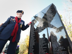 Windsor, Nov. 11: Veteran, George LaBute pays tribute to his brother Bill LaBute, who was in the RCAF and is named on the Essex Memorial Spitfire and Honour Wall in Essex. The Essex Memorial Spitfire and Honour Wall wall is dedicated to the men and women who served with the RAF and RCAF in Second World War.