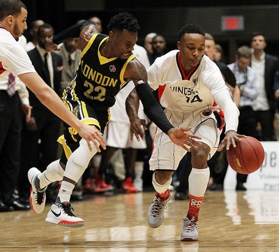 The Windsor Express' Alex Johnson fights for the loose ball with the London Lightnings Tyshawn Patterson during the Clash at the Colosseum at Caesars Windsor on Wednesday, February 3, 2016.
