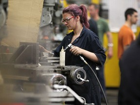 Employees at Centerline Ltd. in Windsor, Ont. are shown on March 31, 2016. A media conference was held at the company to announce government funding for pre-apprenticeship programs in the metal cutting trades.