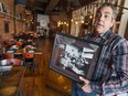 Mark Boscariol, landlord and former business owner of Chanoso's at 255 Ouellette Ave., shows a photo of the eatery's original staff.