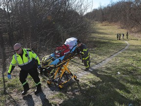 Windsor paramedics and firefighters are shown on a path between University Avenue West and Wyandotte Street West just east of Cameron Avenue on Thursday, March 17, 2016. They were responding to a man that was found unconscious near the walkway. They were able to wake the man up and help him into an ambulance. The incident occurred at approximately 10 a.m.