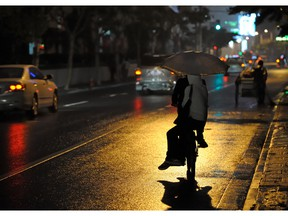 Two people riding a bicycle at night. Photo by fotolia.com.