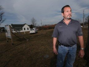 Norbert Bolger of Nor-Built Construction stands next to a lot in Amherstburg he'd like to develop, on March 8, 2016.