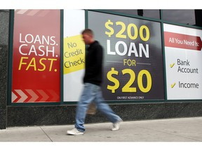 WINDSOR, Ontario.  June 6, 2013. Cheque cashing and payday loans store on Ouellette Avenue at Wyandotte Street in downtown Thursday June 6, 2013. (NICK BRANCACCIO/The Windsor Star)