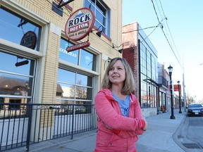Nicole Sekela is shown April 15, 2016 in front of Rock Bottom Bar and Grill and the new Sandwich Brewing Company - two businesses on Sandwich Street she owns with her brother.