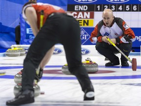 Canada's skip Kevin Koe, right, calls a shot during a play-off game between Canada and Denmark, at the World Men's Curling Championship 2016 in the St. Jakobshalle arena in Basel, Switzerland, on Friday, April 8, 2016.