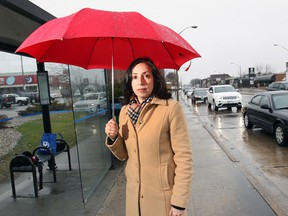 Caroline Grech of CAA South Central Ontario stands at the corner of Tecumseh Road East and Howard Avenue in Windsor on April 9, 2015. Tecumseh Road East is currently leading the area in votes for the title of worst road in the region. (Dan Janisse / The Wndsor Star)