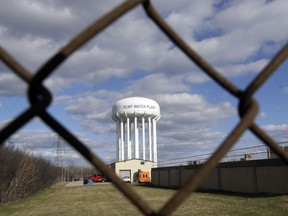 This March 21, 2016 file photo shows the Flint Water Plant water tower in Flint, Mich.