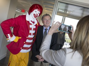 WINDSOR, ON.: MAY 6, 2016 -- Ronald McDonald, left, poses for a photo with Bob Renaud, chair of the board at Windsor Regional Hospital, at the unveiling of the Ronald McDonald House Windsor at Windsor Regional Hospital - Met Campus, Friday, May 6, 2016.  (DAX MELMER/The Windsor Star)
