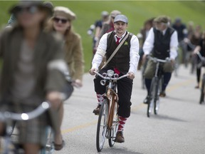 Participants in the 2016 Windsor Tweed Ride make their way along the Windsor riverfront dressed in old stylish attire, Saturday, May 7, 2016.