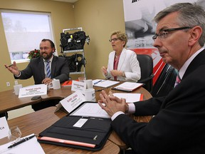 Ontario Premier Kathleen Wynne visited with members of the Automotive Parts Manufacturers Association on Friday, June 19, 2015, at the Magna Closures in Windsor. Wynne is shown with APMA president Flavio Volpe, left, and member Barry Jones.