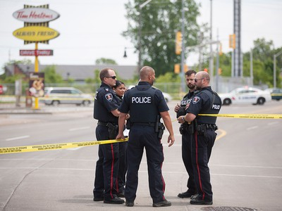 Windsor police officers investigate after a shooting outside the Tim Hortons at Wyandotte St. East and Walker Rd. after a shooting, Wednesday, June 22, 2016.  The assailant is still at large.