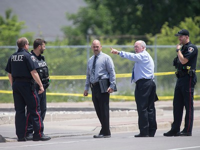 Windsor police detectives investigate outside the Tim Hortons at Wyandotte St. East and Walker Rd. after a shooting, Wednesday, June 22, 2016.  The assailant is still at large.