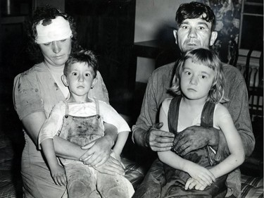 June 19, 1946: Daniel Puskas of Sandwich West undoubtedly saved the lives of his wife and two children when he hurled the children under a haystack, covered his wife with hay and then laid on top of the pile to keep the hay in place when he saw the twister coming. The Puskases are shown with their children Daniel, 4, and Ethel, 6. The youngsters told how the hay was swept away by the tornado leaving them on the ground unharmed. Mrs. Puskas later was struck on the head by a 2x4 flying through the air.