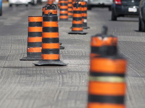 Road construction cones are seen in this file photo.