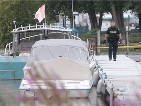 An OPP officer investigates a drowning at the Happy Snapper Marina in Leamington  on Monday, Aug. 15, 2016. A woman on scene said the victim was an elderly boater.