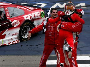 Kyle Larson, driver of the #42 Target Chevrolet, celebrates with crew members after winning the NASCAR Sprint Cup Series Pure Michigan 400 at Michigan International Speedway on Aug. 28, 2016 in Brooklyn, Mich.