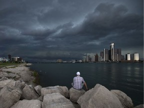 Sherif Messiri watches as a storm front moves into Windsor from Michigan, Saturday, August 27, 2016.